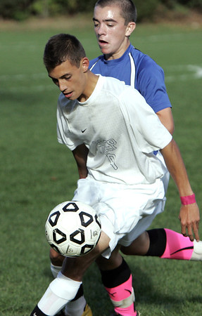 Danvers:<br /> St. John's Prep's Michael Lanza, has the ball with Danvers' Mike Powers shadowing behind at the Danvers at St. John's Prep boys soccer game.<br /> Photo by Ken Yuszkus, The Salem News,  Monday, October 14, 2013.