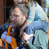 Topsfield:<br /> Gracie McGhan, 3, rides on her father Andrew's shoulders while navigating through the crowd at the Topsfield Fair on the last day of the fair.<br /> Photo by Ken Yuszkus, The Salem News,  Monday, October 14, 2013.