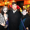 Salem: From left, Kelsey D'Anneo, Greg Idaris, and Cara Goldman, of Boston, enjoy the festivities of Halloween night on Essex St. in Salem. David Le/Salem News