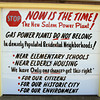 Salem: On the garage doors of a home on Fort Avenue in Salem there are protest signs that have been put up opposing the plans to build a new gas-fired plant at the site of the current power plant. David Le/Salem News
