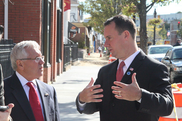Former Peabody Mayor Mike Bonfanti, left, speaks with current Mayor Ted Bettencourt at the Main Street Corridor Realignment project groundbreaking Oct. 16. Both mayors played a role in securing state funds for the project. <br /> Staff photo by Alan Burke