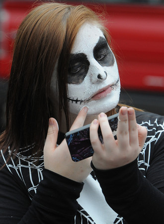 Salem:<br /> Shannon McCullough of Attleboro, MA, applies makeup before roaming the streets of Salem on Halloween.<br /> Photo by Ken Yuszkus / The Salem News, Thursday, October 31, 2013.