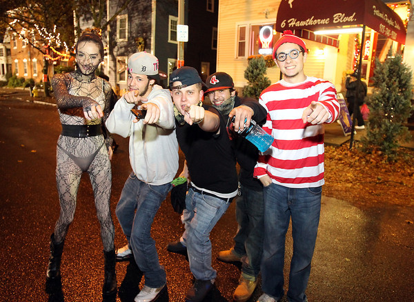 Salem: From left, Chelsey Angers, of Haverhill, Mike Goodwin, Chris Sbonik, and Kyle Almquist, of Salem, and Mark McEntee, of Swampscott pose for a photo on Halloween evening. David Le/Salem News
