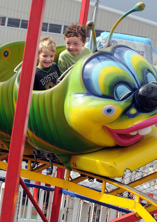 Topsfield:<br /> Ben Shugrue, 5, left, and his friend Whit Thielsher, 5, of Topsfield, ride the Wacky Worm at the Topsfield Fair. The two boys got out of going to kindergarten to go to the fair. <br /> Photo by Ken Yuszkus, The Salem News, Monday, October 07, 2013.