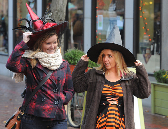 Salem:<br /> Erin Briscoe, left, and Julie Quinlan walk down Essex Street in Salem in their Halloween attire.<br /> Photo by Ken Yuszkus / The Salem News, Wednesday, October 30, 2013.
