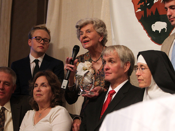 Danvers: Joanne Holbrook Patton, center, addresses a packed room at Danversport Yacht Club after she received the Essex Heritage Hero Award, while surrounded by her family on Wednesday evening. David Le/Salem News