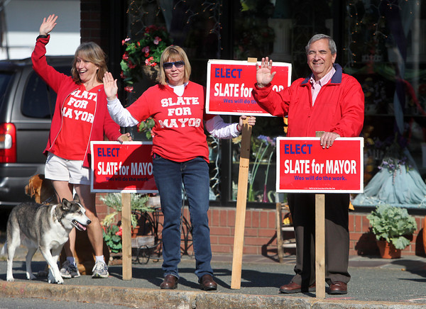 Beverly: Beverly Mayoral candidate Wes Slate, right, waves to passing cars while campaigning outside Carroll's Florist at the corner of Rantoul and Cabot Streets on Saturday morning, with his wife Georgia Bills, center and Elaine Collupy. David Le/Salem News
