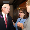 Salem: District Attorney Jonathan Blodgett, left, smiles while talking with his wife, Judy Blodgett, center, and Maureen Colby, right, on Thursday evening prior to the start of a dinner held at the Kernwood Country Club by the Anti-Defamation League of New England to honor Blodgett. David Le/Salem News