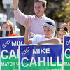 Beverly: Beverly Mayoral candidate Mike Cahill waves to passing cars outside the Walgreens on the corner of Rantoul and Elliott Streets on Saturday morning with his nephew Justin Cahill, 10. David Le/Salem News