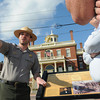Salem:<br /> Park ranger Jonathan Parker speaks to tourists Bryan Johnson of Utah and Curt Johnson of Maine in front of the Custonm House on his first day back on the job since the government shutdown.<br /> Photo by Ken Yuszkus, The Salem News,  Thursday, October 17, 2013.