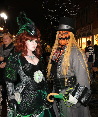Salem: Jessica Jackson, of Stoneham, and Brian Chamberlin, of Taunton, pose for a photo along the Essex St. pedestrian mall on Halloween evening. David Le/Salem News