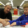 Danvers: Eight-year-old Steven Reardon of Danvers gets help from his father Steve, while decorating a pumpkin CD on Thursday evening at the Peabody Institute Library in Danvers. David Le/Salem News