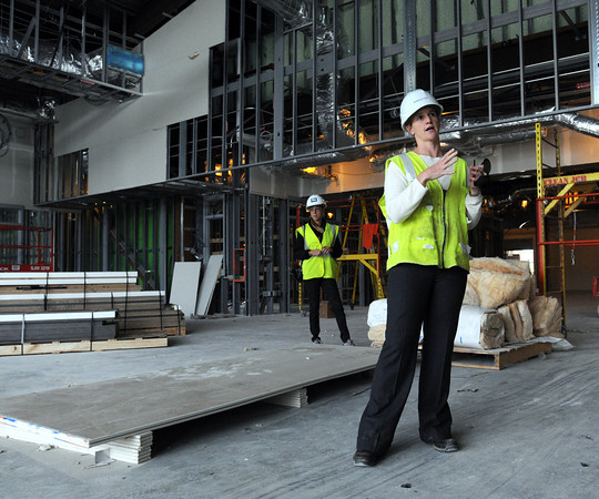 Danvers:<br /> Architect Dawn Guarriello explains the media center where she is standing while conducting a tour of the $133 million Essex Tech High in Danvers.<br /> Photo by Ken Yuszkus, The Salem News,  Thursday, October 17, 2013.