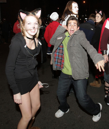 Jordan Peoples, left, of Plymouth, and Andrew Viscenti, right, of Norwood dance along to the concert on Halloween night. David Le/Staff Photo.