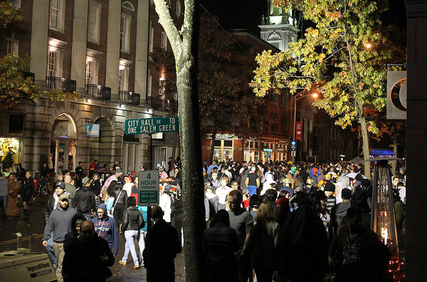 Salem: A huge throng of Halloween-goers stream down Washington and Essex Streets at the end of Halloween night on Thursday. David Le/Salem News