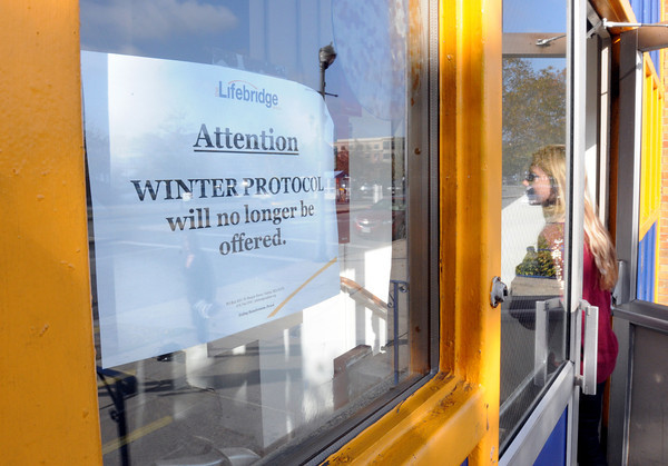"Salem:<br /> The sign on door at Lifebridge reads: ""Attention: Winter Protocol Will No Longer Be Offerred.""<br /> Photo by Ken Yuszkus, The Salem News,  Thursday, October 17, 2013."