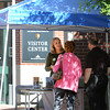 Salem:<br /> Stacia Cooper from Destination Salem gives directions to tourists at the information tent set up near the Visitors Center which is closed.<br /> Photo by Ken Yuszkus, The Salem News, Tuesday, October 01, 2013.