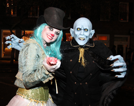 Salem: Marlinda and Joey Phillips, of Atlanta, GA, enjoy the Halloween festivities in downtown Salem on Thursday evening. David Le/Salem News