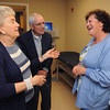 "Danvers:<br /> From left, Sandra and George Pappas of Peabody speak with LPN Katherine Guerrette in one of the exam rooms while on tour at the open house for new ""Urgent Care"" facility at Mass General/North Shore Center for Outpatient Care<br /> Photo by Ken Yuszkus, The Salem News, Wednesday, October 02, 2013."