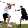 "Beverly:<br /> Joe Dix, left, and Matt Berry practice stick fighting at Dane Street Beach. Matt Berry is training for the upcoming fund raising event for cancer, ""Beat The Crap Out Of Cancer"", in Toronto, Canada on November 9.<br /> Photo by Ken Yuszkus, The Salem News,  Tuesday, October 15, 2013."