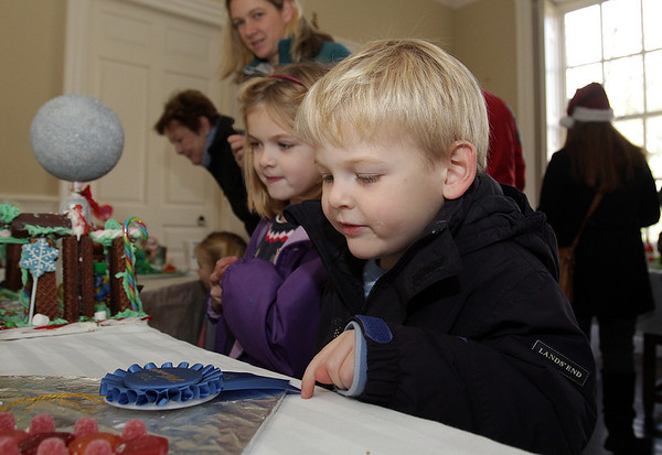 Jack Bickell, 4, and his sister Kate, 6, of Marblehead look at some gingerbread houses on display at the Lee Hooper Mansion on Sunday. David Le/Salem News