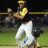 Danvers American's Thomas Mento slides safely into second base ahead of the tag from Saugus American's Mike Watson.