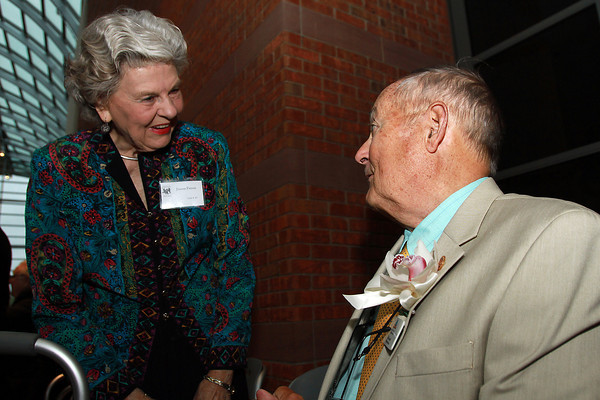 Tom Leonard, right, talks with Joanne Patton, left, at a reception in Leonard's honor, as the 2012 Essex Heritage Hero recipient. David Le/Staff Photo