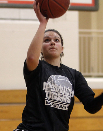 Ipswich's Shannon McFayden goes in for a layup during practice. David Le/Salem News