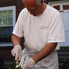Salem: Chef Giovanni Grazziani crushes some fresh basil for his homemade pesto during the Salem Farmers Market held in Derby Square in Thursday afternoon. Photo by David Le/Salem News