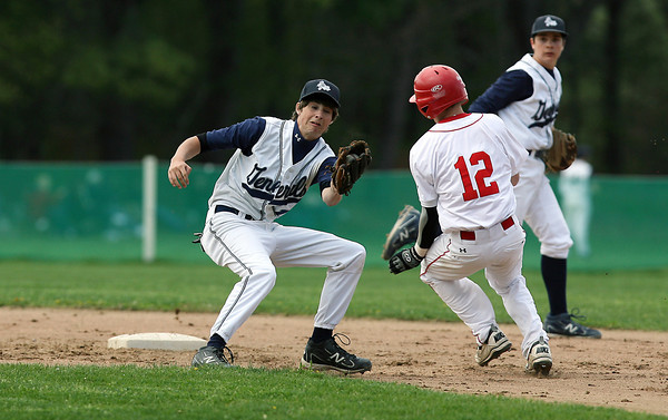 Masco baserunner JR Sheehan (12) right, manages to squeeze around Hamilton-Wenham second baseman Tom Conville, left, and safely slides into the base. David Le/Staff Photo