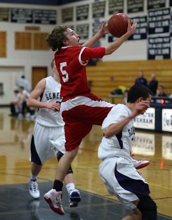 Masco point guard Alex Brown goes in for a fast break layup over a Hamilton-Wenham defender. David Le/Salem News