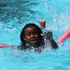 Salem: Naima Hassan, 6, of Salem stretches to reach the wall of the Forest River Park swimming pool during a free lesson on Thursday afternoon. The Forest River Park pool offers free swimming lessons to all Salem residents. Photo by David Le/Salem News