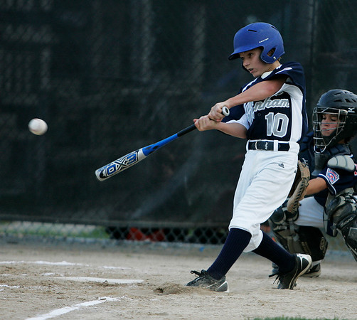 Ipswich: Hamilton-Wenham centerfielder Sam Ober lines a double into the gap off Peabody West starting pitcher Traverse Briana in the second inning of their contest Tuesday evening at Bowen Field in Ipswich. Photo by David Le/Salem News