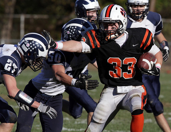 Beverly running back Brendan Flaherty(33) stiffarms a Swampscott defender as he rushes for positive yards on Saturday afternoon. David Le/Salem News