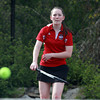 Salem senior captain Michaela Gaffney keeps her eyes on her serve against Marblehead during first singles play. David Le/Staff Photo