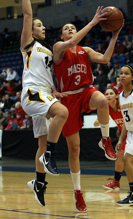 Masco senior Chelsea Nason (3) right, gets fouled as she drives to the lane by Andover's Rebecca Alois (14), left, on Saturday afternoon. David Le/Staff Photo