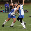 Danvers High School's Ashlee Ataya, left, high fives teammate Courtney Torchia after the Falcons scored against Lincoln-Sudbury. Danvers built an early 2-0 lead, but couldn't hold onto it, dropping 3-2 in OT. David Le/Salem News