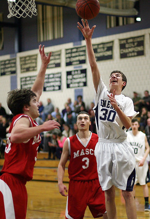 Hamilton-Wenham freshman James Foye (30) right, goes up strong for a layup as Masco's Sean Antonuccio (33) left, goes up for the block. David Le/Salem News