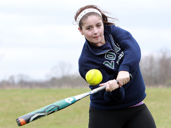 Pingree sophomore Ellie diCicco concentrates on making contact with the ball during a hitting drill at practice on Wednesday afternoon. David Le/Staff Photo