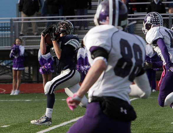 Hamilton-Wenham wide receiver Matt Putur hauls in a long touchdown pass from quarterback Trevor Lyons against Bourne High School on Saturday afternoon. David Le/Salem News