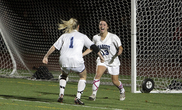 Peabody High School junior Victoria Digiacomo (13) is met by teammate Katie Brunnelle (1) after Digiacomo scored a goal in OT to propel the Tanners to a 2-1 win over Oliver Ames on Tuesday night, David Le/Salem News