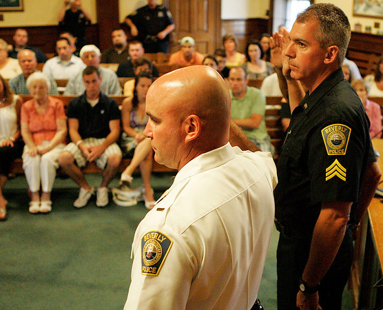 Beverly: Beverly Police Officers Lt. Joseph Shairs, left, Sgt. David Faustino, and Sgt. Richard Russo, not pictured, raise their right hands and swear into their new positions during a promotion ceremony held on Tuesday evening at Beverly City Hall. Photo by David Le/Salem News