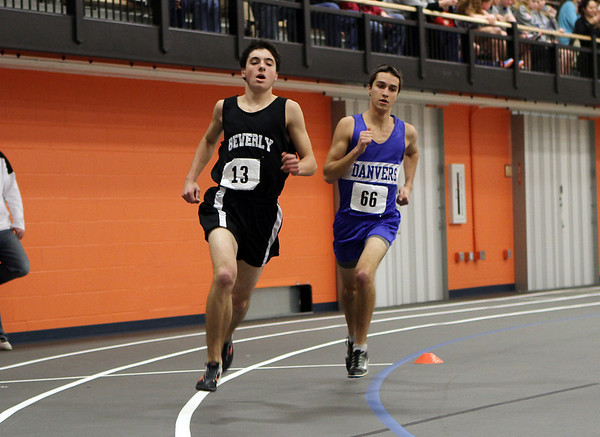 Beverly: Beverly's Alex Greco, left, and Danvers' Brian Hebert, right, compete in the mile race on Thursday. David Le/Salem News
