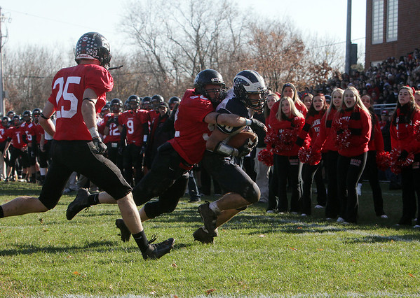 Marblehead's Oliver Gregory (52) drags down Swampscott's Mark Lausier before he can get into the endzone as Zac Cuzner closes in. David Le/Salem News