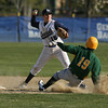Hamilton-Wenham shortstop Austen Michel (15) throws to first around a sliding North Reading baserunner on Tuesday afternoon. David Le/Staff Photo