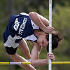 Hamilton-Wenham pole vaulter Jared Rokowski soars over the bar on Wednesday afternoon. David Le/Staff Photo