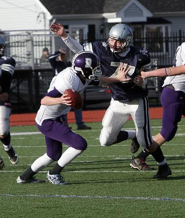 Hamilton-Wenham's Matt Vogus (77) closes in on Bourne quarterback Jason Moriarty on Saturday afternoon. David Le/Salem News