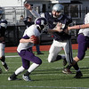Hamilton-Wenham's Matt Vogus (77) closes in on Bourne quarterback Jason Moriarty on Saturday afternoon. David Le/Salem News