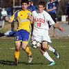 Masco's Wes Shrewsbury (10) right, fights for possession of the ball with Acton-Boxborough's David Lush (17) left, on Wednesday afternoon. David Le/Salem News