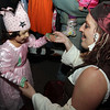Evannie Meza, 4, of Beverly, dances with Rhiannon Defranco on Washington St. on Monday night. David Le/Staff Photo.